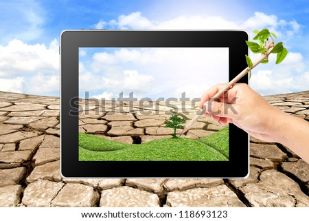 Hand writing Think Green Ecology on tablet - stock photo