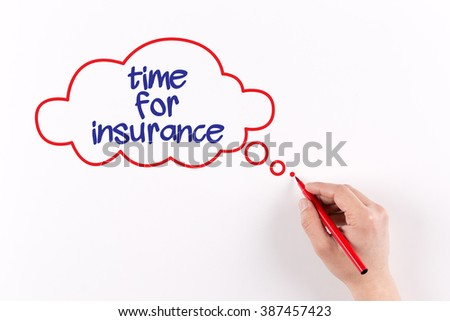 Hand writing Time For Insurance on white paper, view from above - stock photo