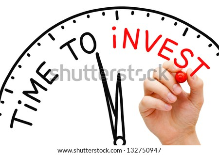 Hand writing Time to Invest concept with red marker on transparent wipe board. - stock photo