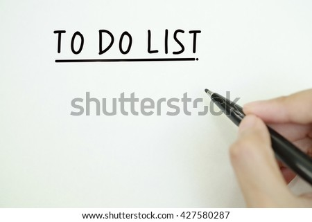 hand writing to do list concept on paper , business concept , business idea , strategy concept, business solution, business analysis - stock photo