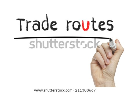 Hand writing trade routes on a white board - stock photo