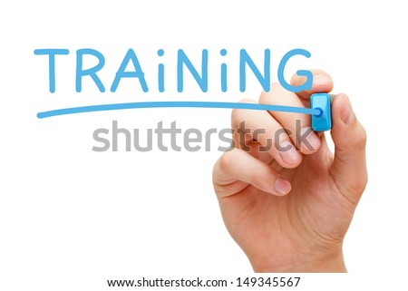 Hand writing Training with blue marker on transparent wipe board. - stock photo