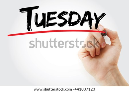 Hand writing Tuesday with marker, concept background - stock photo
