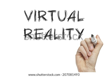 Hand writing virtual reality on a white board - stock photo