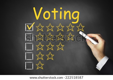 hand writing voting on blackboard - stock photo