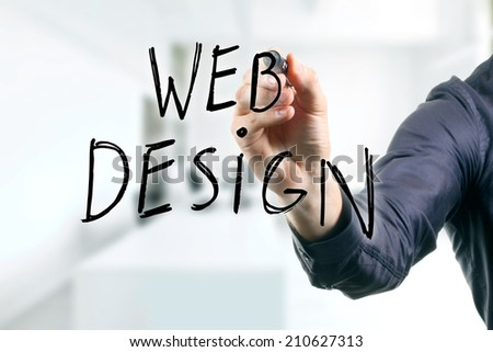 hand writing web design with black marker - stock photo