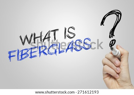 Hand writing what is fiberglass on grey background - stock photo