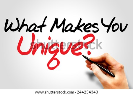 Hand writing What Makes You Unique?, business concept  - stock photo