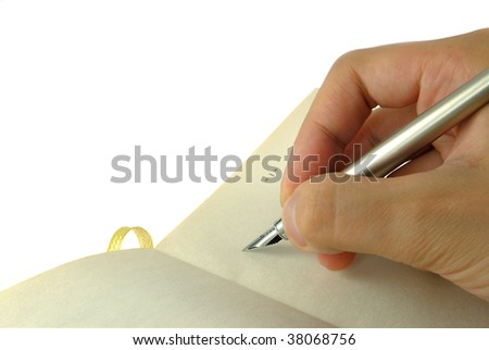Hand writing with a fountain pen, on a blank notebook. Isolated on white background - stock photo