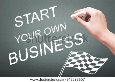 Hand writing with chalk start your own business concept on blackboard - stock photo