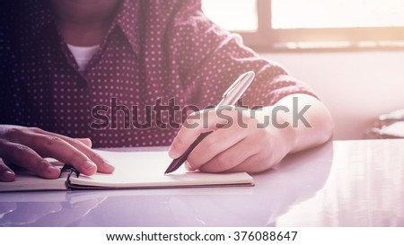 hand writing with hand left - stock photo