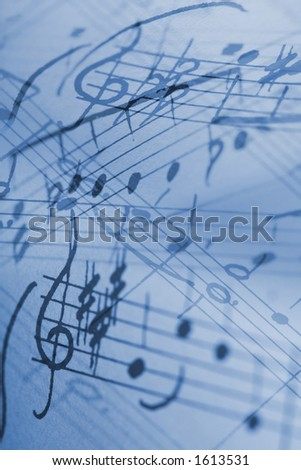 hand-written musical notation background. - stock photo