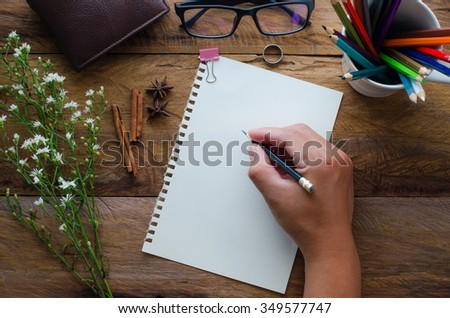 Hand-written note on a wooden table. - stock photo