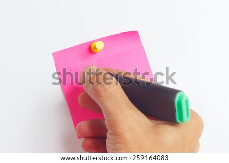 Hand written notes a green marker on a red sticker on a white board - stock photo