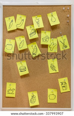 hand written post it on cork board - stock photo