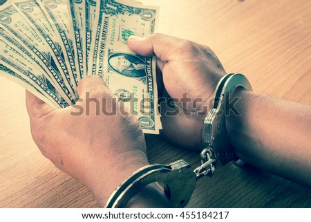 Hand young man in handcuffed hold money vintage tone - stock photo