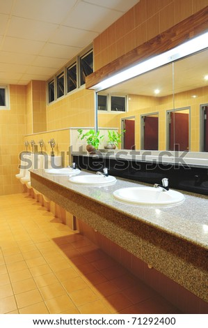 Handbasin and mirror in toilet - stock photo
