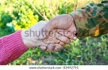 handclasp between elderly people outdoor - stock photo