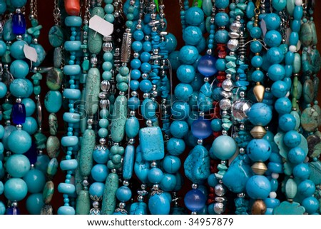 Handcrafted blue gemstone jewelry on open air market - stock photo