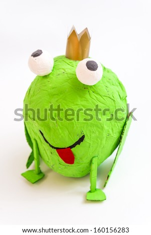 handcrafted frog, made with a balloon and Paper - stock photo