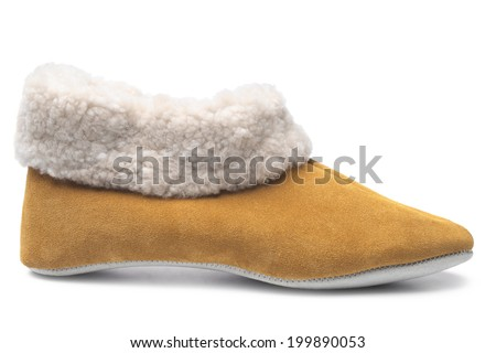 Handcrafted leather slipper with wool lining on white background - stock photo