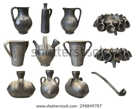 Handcrafted traditional black pottery set collection isolated on white background - stock photo