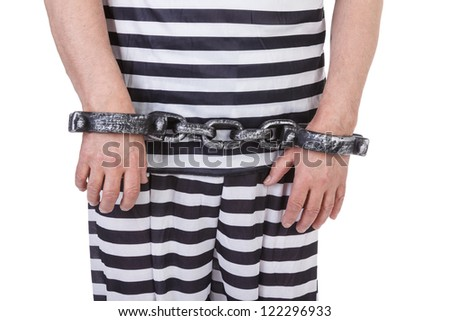 handcuffed hands against white background - stock photo