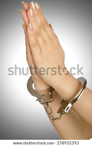 Handcuffed hands on white background - stock photo