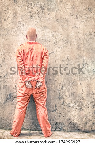 Handcuffed prisoner in Jail waiting for Death Penalty - stock photo