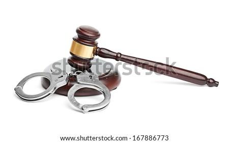 handcuffs and gavel - stock photo