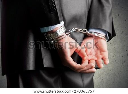 Handcuffs, Arrest, White Collar Crime. - stock photo