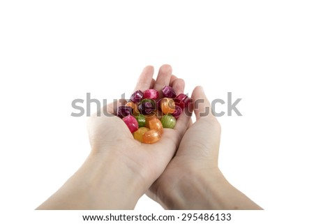 handful colorful candies isolated over white - stock photo