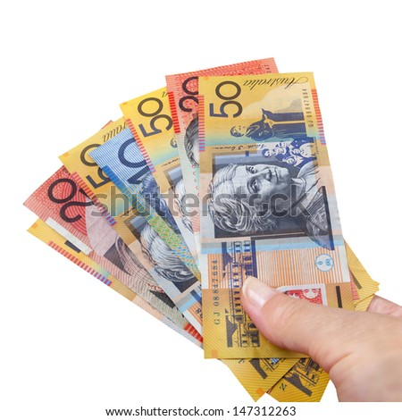 Handful of Australian money, isolated over white, - stock photo