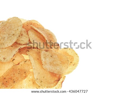 Handful of Flavored Potato Crisps Against a Plain White Background Isolated Against White With Copy Space - stock photo