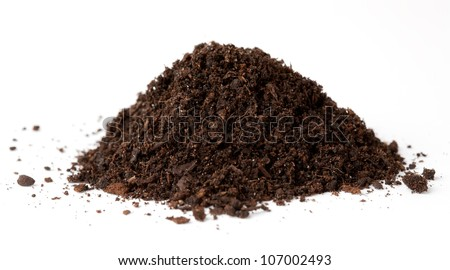handful of ground on a white background - stock photo