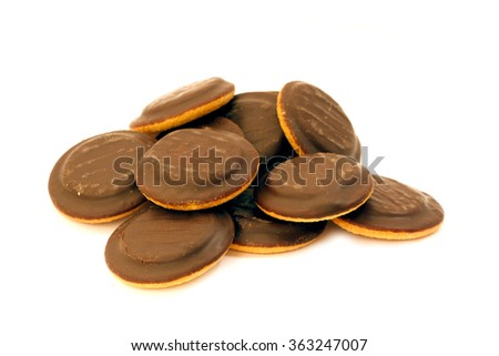 Handful of many delicious chocolate biscuit cookies isolated on white background - stock photo