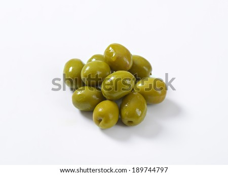 handful of pickled green olives - stock photo