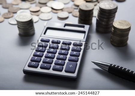 handful of Russian rubles with calculator close up - stock photo