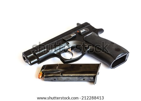 handgun and bullets magazine on white background - stock photo