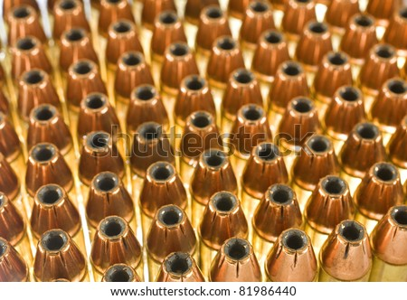 handgun cartridges that are loaded with hollow point bullets - stock photo