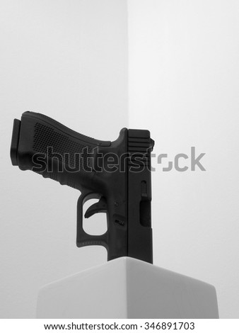 handgun in a white vase on white background - stock photo