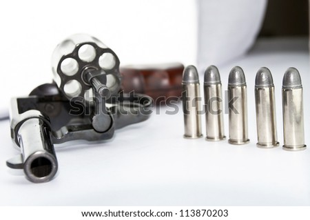 handgun revolver with bullets on white background - stock photo
