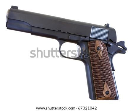 handgun that is still in use that was designed in 1911 - stock photo