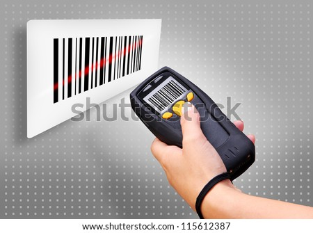 Handheld Computer for wireless barcode scanning identification - stock photo