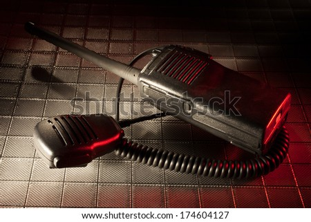 handheld emergency radio with a microphone and red gel below - stock photo