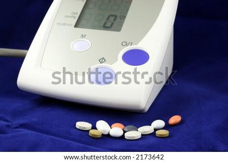 Handheld portable blood pressure monitor - stock photo