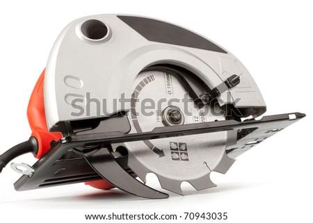 Handherd circular saw on a white background - stock photo