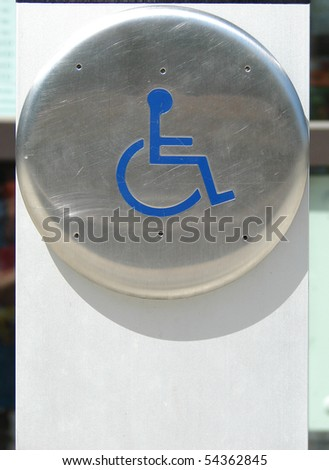 handicap automatic door opener button with space for copy - stock photo