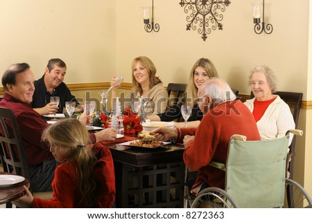 handicap grandfather and family having dinner - stock photo