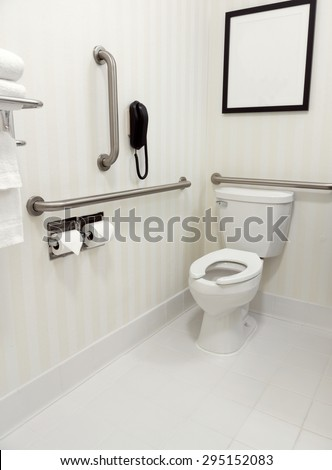 Handicapped disability access bathroom with grab bars and toilet - stock photo